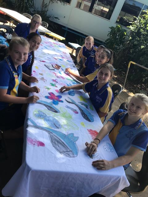 "Kalkie State School students eating their ""Fantastic Not Plastic"" cloth bags"